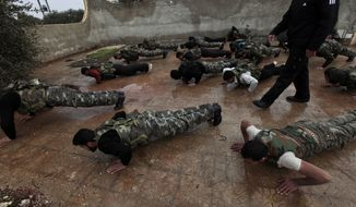 **FILE** Syrian rebels attend a training session in Maaret Ikhwan, near Idlib, Syria, on Dec. 17, 2012. The training is part of an attempt to transform the rag-tag rebel groups into a disciplined fighting force. (Associated Press)