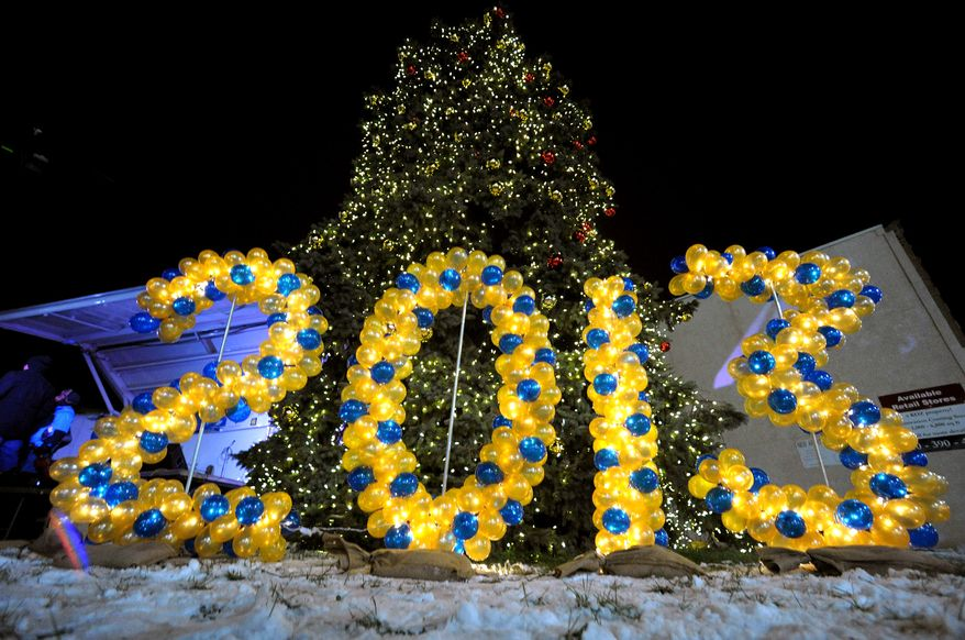 Balloons spell out the number 2013 at an outdoor festival to celebrate the end of Allentown's 250th year Monday, Dec. 31, 2012, in Allentown, Pa. (AP Photo/The Express-Times, Matt Smith)