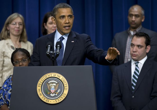 "**FILE** President Obama gestures as he speaks about the ""fiscal cliff"" on Dec. 31, 2012, in the South Court Auditorium at the White House in Washington. (Associated Press)"