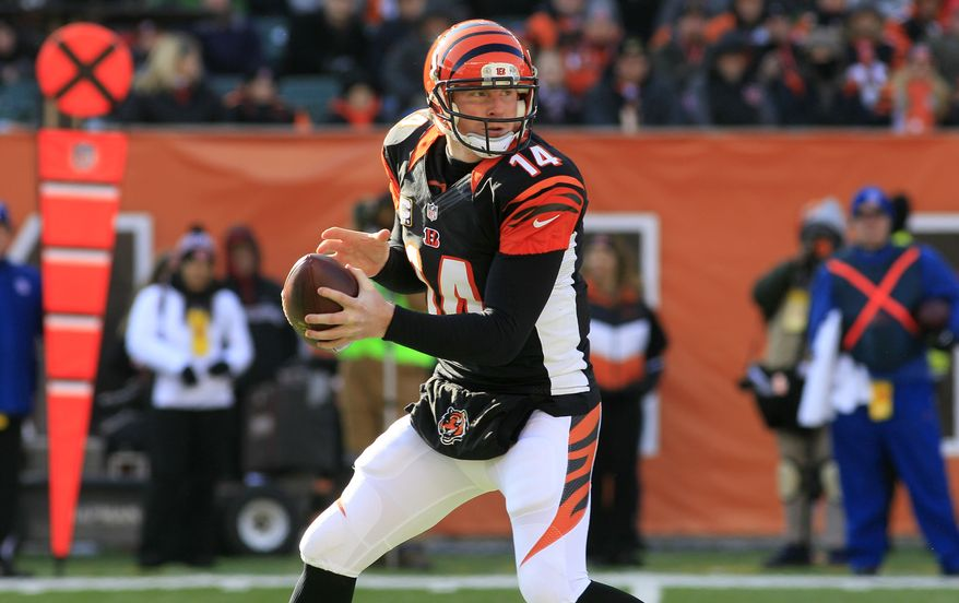 Cincinnati Bengals quarterback Andy Dalton looks to pass against the Baltimore Ravens in the first half of an NFL football game, Sunday, Dec. 30, 2012, in Cincinnati. (AP Photo/Tom Uhlman)