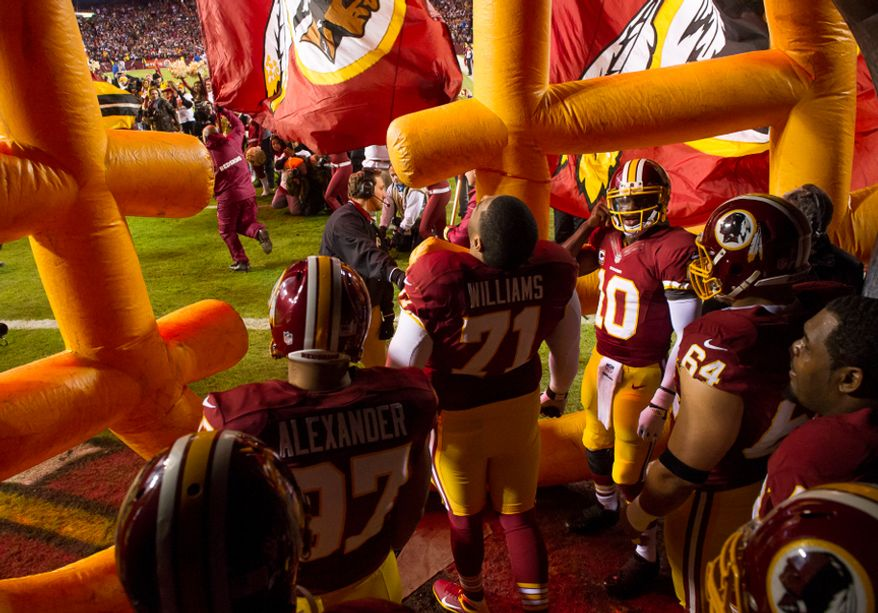 Quarterback Robert Griffin III (10), third from right, and the Redskins wait to take the field before the Washington Redskins play the Dallas Cowboys at FedEx Field, Landover, Md., Sunday, Dec. 30, 2012. (Andrew Harnik/The Washington Times)