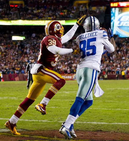 Washington Redskins cornerback Richard Crawford (39) can't stop Dallas Cowboys wide receiver Kevin Ogletree (85) from scoring on a 10-yard pass in the fourth quarter at FedEx Field, Landover, Md., Sunday, Dec. 30, 2012. (Andrew Harnik/The Washington Times)