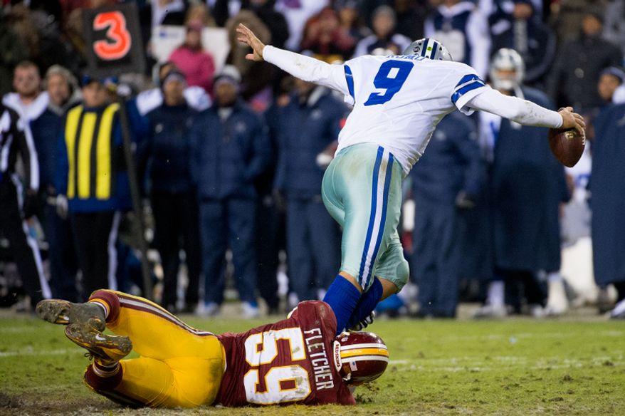 Washington Redskins inside linebacker London Fletcher (59) sacks Dallas Cowboys quarterback Tony Romo (9) in the fourth quarter at FedEx Field, Landover, Md., Sunday, Dec. 30, 2012. (Andrew Harnik/The Washington Times)