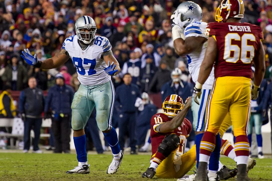 Dallas Cowboys defensive end Jason Hatcher (97) reacts as he is called for roughing the passer late in the fourth quarter to help the Washington Redskins run out the clock at FedEx Field, Landover, Md., Sunday, December 30, 2012. (Andrew Harnik/The Washington Times)