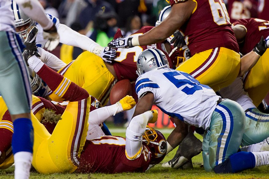 Officials ruled that Washington Redskins running back Alfred Morris (46) scored on this 1-yard touchdown play that saw him lose the ball after crossing the goal line as the Washington Redskins play the Dallas Cowboys at FedEx Field, Landover, Md., Sunday, Dec. 30, 2012. (Andrew Harnik/The Washington Times)