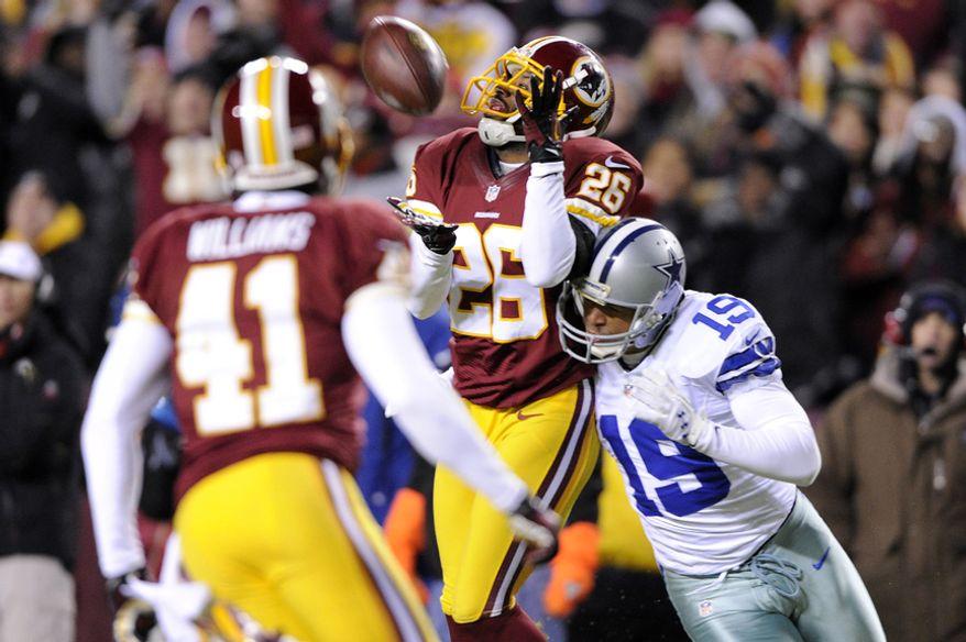 Washington Redskins cornerback Josh Wilson (26) intercepts a second-quarter pass intended for Dallas Cowboys wide receiver Miles Austin (19) at FedEx Field, Landover, Md., Dec. 30, 2012. (Preston Keres/Special to The Washington Times)