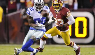 Dallas Cowboys wide receiver Dez Bryant (88) hauls in a first down reception in front of Washington Redskins cornerback DeAngelo Hall (23) during second-quarter action at FedEx Field, Landover, Md., Dec. 30, 2012. (Preston Keres/Special to The Washington Times)
