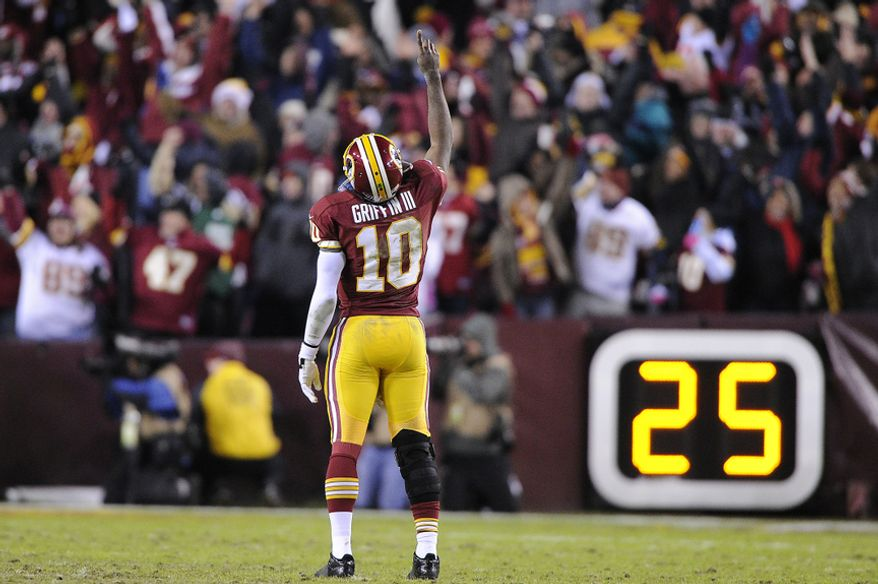 Washington Redskins quarterback Robert Griffin III (10) celebrates running back Alfred Morris' 32-yard touchdown run in the fourth quarter at FedEx Field, Landover, Md., Dec. 30, 2012. (Preston Keres/Special to The Washington Times)