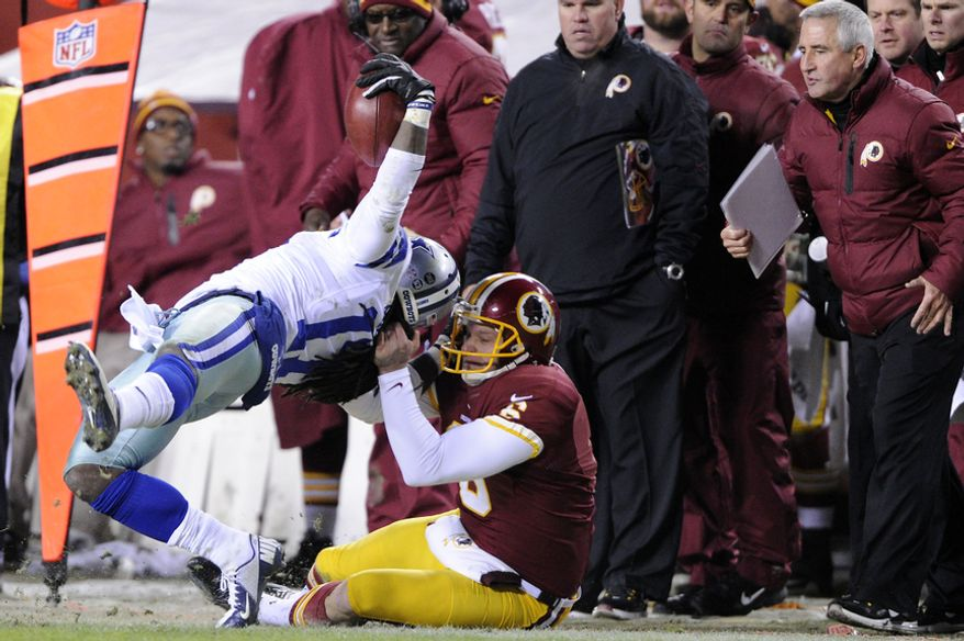 Washington Redskins punter Sav Rocca (6) hauls down Dallas Cowboys wide receiver Dwayne Harris (17) by the facemask and the hair during a fourth quarter punt return at FedEx Field, Landover, Md., Dec. 30, 2012. (Preston Keres/Special to The Washington Times)