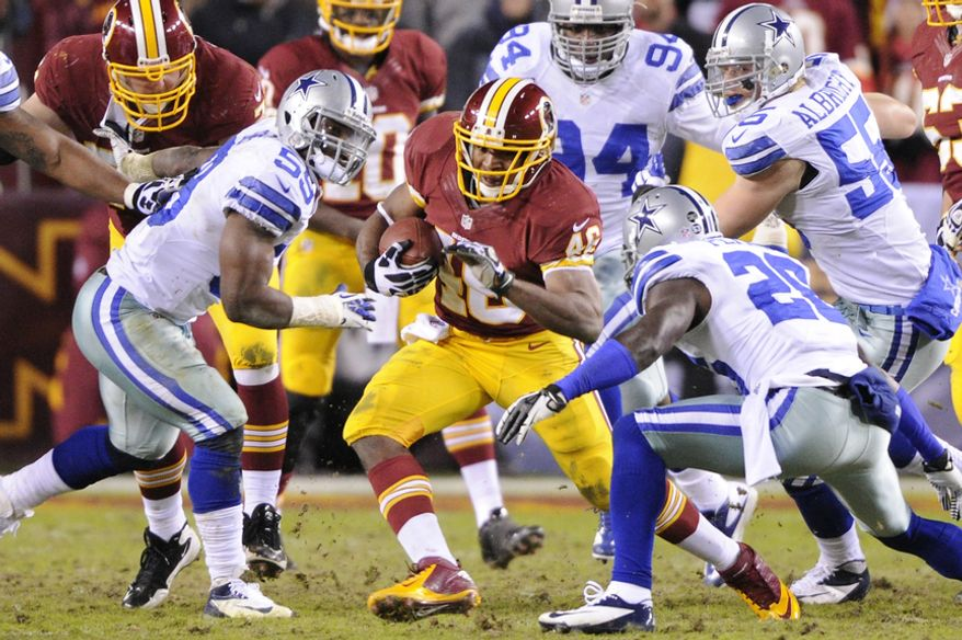 Washington Redskins running back Alfred Morris (46) breaks through the Dallas defense for a first-down run in the third quarter. Morris broke the franchise's season rushing record on the play at FedEx Field, Landover, Md., Dec. 30, 2012. (Preston Keres/Special to The Washington Times)