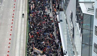 Police said 26,000 people joined the march at its peak Tuesday while organizers said 130,000 took part, with some demonstrators sporting Guy Fawkes masks. The protests came half a year after Mr. Leung, who was chosen by a 1,193-member committee, took office. (Associated Press)
