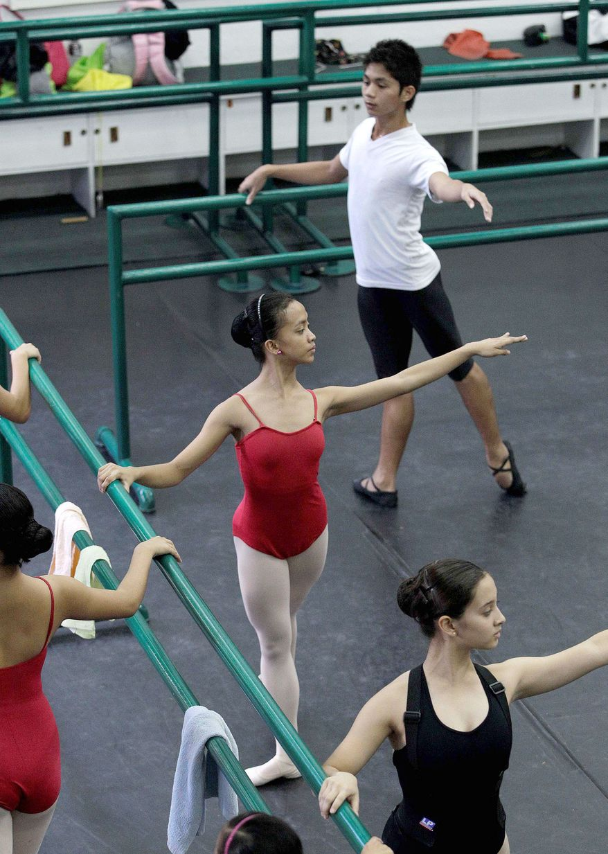 Filipino slum dwellers Jessa Balote (center) and Jamil Montebon (top) practice with other students during a class at Ballet Manila. Aside from well-off students, the school picks scholars among kids living in slum areas of Manila and enrolls them in the dance scholarship program where they are given a monthly stipend. (Associated Press)