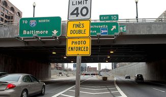 The speed limit at the Third Street Tunnel, normally 45 mph, was marked 40 mph for a work zone. Although the work zone seems to be gone, the speed limits have not been readjusted. A police officer who was nabbed by one of the cameras is demanding a second look at thousands of tickets issued. (Barbara L. Salisbury/The Washington Times)