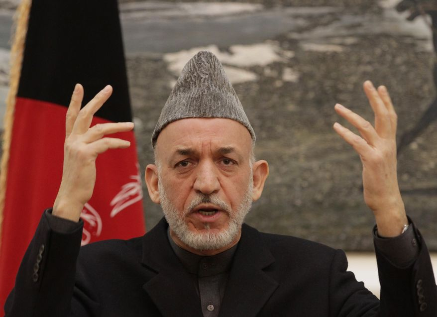 Afghan President Hamid Karzai gestures during a press conference at the presidential palace in Kabul, Afghanistan, on Saturday, Dec. 8, 2012. (AP Photo/Ahmad Jamshid)