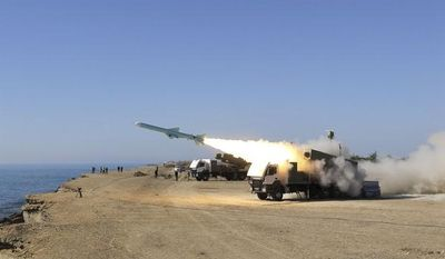 A Ghader missile is launched from the area near the Iranian port of Jask, on the shore of the Gulf of Oman, during an Iranian navy drill on Tuesday, Jan. 1, 2013. (AP Photo/Jamejam Online, Azin Haghighi)