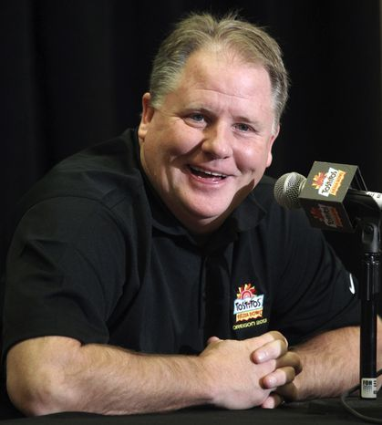 Oregon head coach Chip Kelly laughs as he answers a reporter's question during media day for the Fiesta Bowl NCAA college football game, Monday, Dec. 31, 2012, in Scottsdale, Ariz. Oregon is scheduled to play Kansas State on Jan. 3, 2013, in Glendale. (AP Photo/Paul Connors)