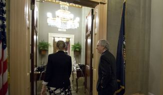 "Senate Minority Leader Mitch McConnell (right), Kentucky Republican, returns to his office after a vote on the ""fiscal cliff"" deal on Capitol Hill on Tuesday, Jan. 1, 2013, in Washington. (AP Photo/Alex Brandon)"