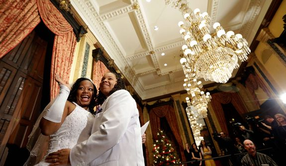 Darcia Anthony (left) and Danielle Williams hug after their wedding ceremony at City Hall in Baltimore on Tuesday, Jan. 1, 2013. Same-sex couples in Maryland are now legally permitted to marry under a new law that went into effect after midnight on Tuesday. Maryland is the first state south of the Mason-Dixon Line to approve same-sex marriage. (AP Photo/Patrick Semansky)