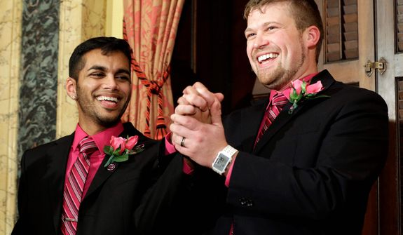 Shehan Welihinda (left) and Ryan Wilson react after their marriage at City Hall in Baltimore on Tuesday, Jan. 1, 2013. Same-sex couples in Maryland are now legally permitted to marry under a new law that went into effect after midnight on Tuesday. Maryland is the first state south of the Mason-Dixon Line to approve same-sex marriage. (AP Photo/Patrick Semansky)