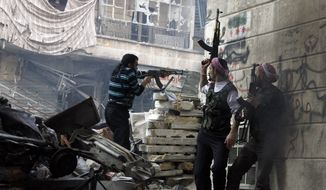 Free Syrian Army fighters fire at enemy positions during heavy clashes with government forces in the Salaheddine district of Aleppo, Syria, on Saturday, Dec. 29, 2012. (AP Photo/Abdullah Al-Yasin)