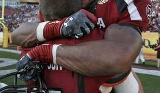 South Carolina running back Kenny Miles (31) celebrates with quarterback Dylan Thompson (17) after they defeated Michigan 33-28 in the Outback Bowl NCAA college football game, Tuesday, Jan. 1, 2013, in Tampa, Fla.  (AP Photo/Chris O'Meara)