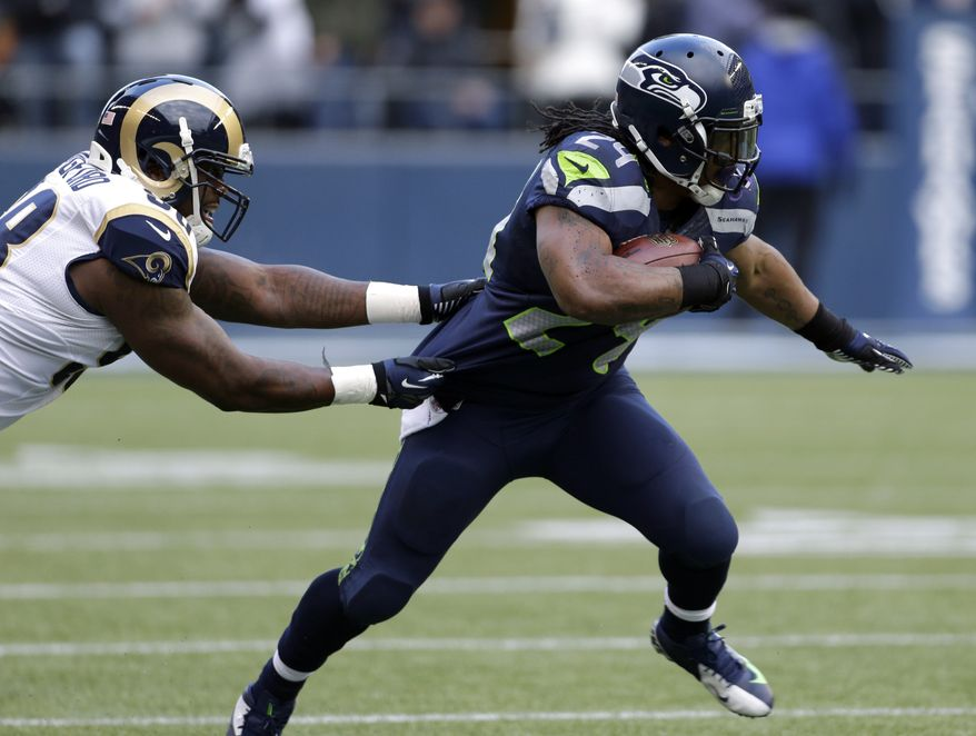St. Louis Rams' Kendall Langford, left, chases Seattle Seahawks' Marshawn Lynch in the first half of an NFL football game, Sunday, Dec. 30, 2012, in Seattle. (AP Photo/Elaine Thompson)