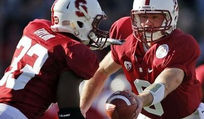 Stanford quarterback Josh Nunes, right, hands off to running back Stepfan Taylor during the first half of the Rose Bowl college football game against Wisconsin, Tuesday, Jan. 1, 2013, in Pasadena, Calif. (AP Photo/Jae C. Hong)