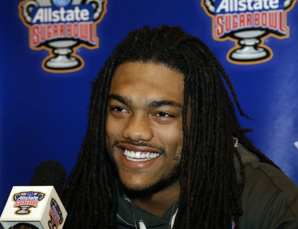 Florida defensive back Josh Evans is all smiles as he answers questions at a news conference in New Orleans, Saturday, Dec. 29, 2012. Florida will face Louisville in the Sugar Bowl NCAA college football game on Jan. 2, 2013. (AP Photo/Bill Haber)