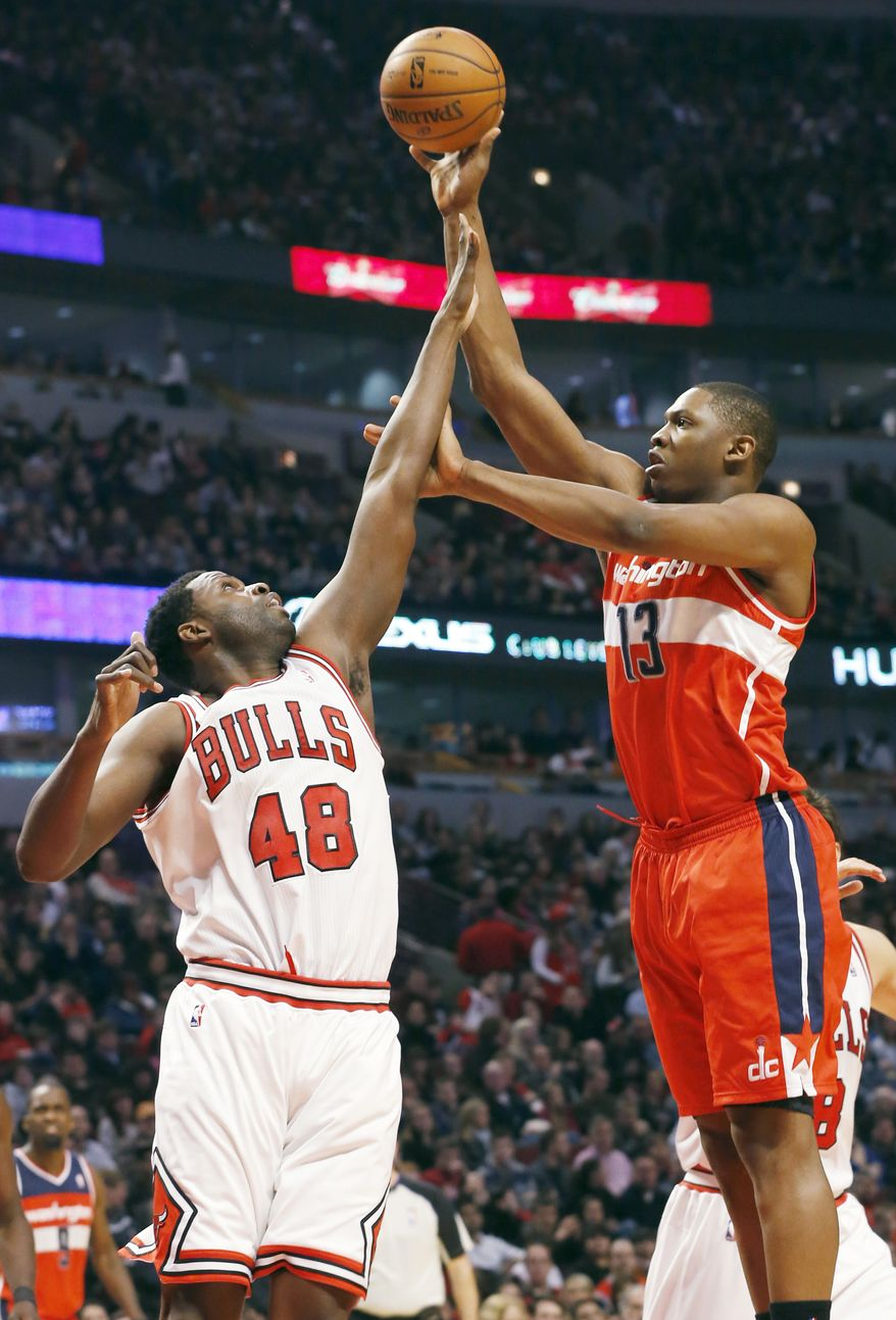 Washington Wizards center Kevin Seraphin, of France, right, shoots over Chicago Bulls center Nazr Mohammed during the first half of an NBA basketball game in Chicago on Saturday, Dec. 29, 2012. (AP Photo/Nam Y. Huh)
