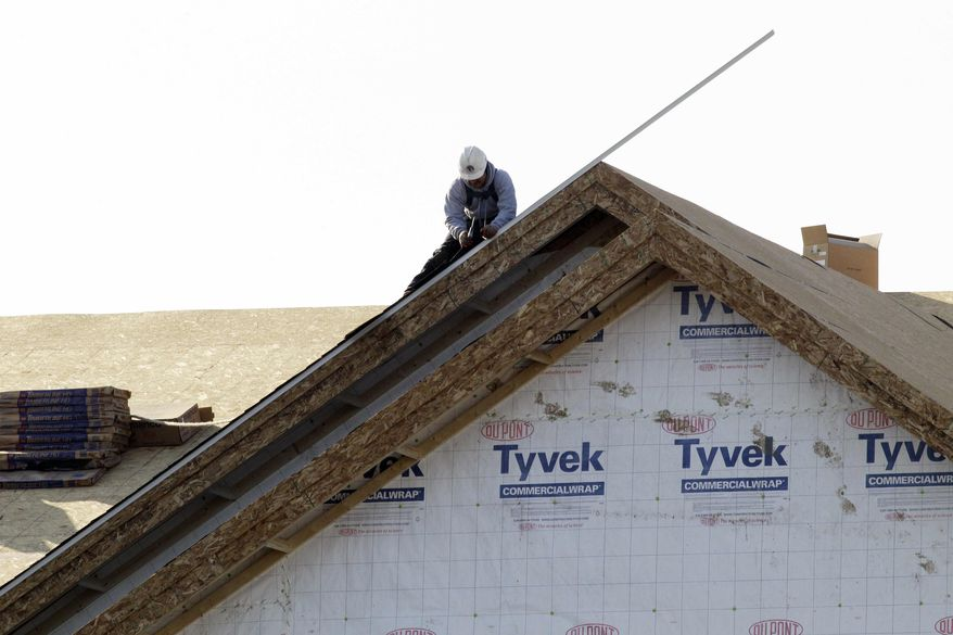 ** FILE ** In this Nov. 28, 2012, photo, a worker constructs a home in Chicago. (AP Photo/Nam Y. Huh)