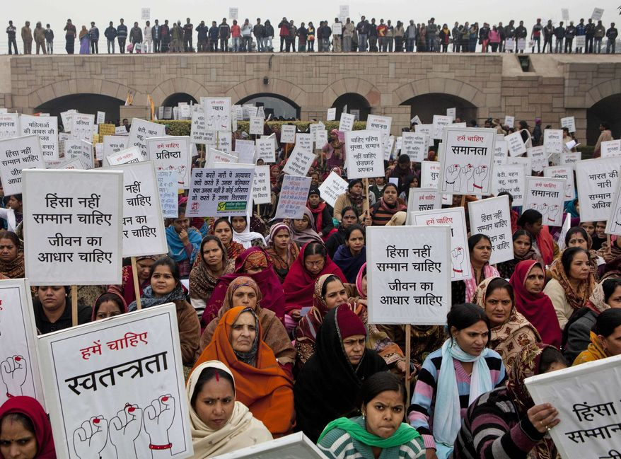 Indian women carry placards and banners as they offer prayers for a gang rape victim, at Mahatma Gandhi memorial, in New Delhi, India, Wednesday, Jan. 2, 2013. (AP Photo/ Dar Yasin)