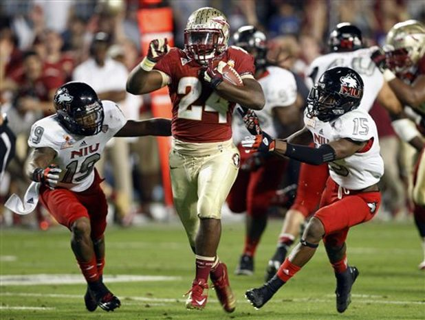 Northern Illinois cornerback Demetrius Stone (19) and defensive back Jimmie Ward (15) can't hold onto Florida State fullback Lonnie Pryor (24) on his way to a touchdown during the second half of the Orange Bowl college football game, Tuesday, Jan 1, 2013, in Miami. (AP Photo/Alan Diaz)