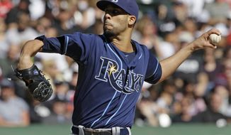 FILE - Tampa Bay Rays starter David Price throws against the Chicago White Sox during the first inning of a baseball game in Chicago, in this Sept. 30, 2012 file photo. The three-time All-Star and the Tampa Bay Rays have agreed to a one-year contract worth just over $10 million, avoiding arbitration a person with knowledge of the deal said Tuesday night Jan. 1, 2013. (AP Photo/Nam Y. Huh, File)