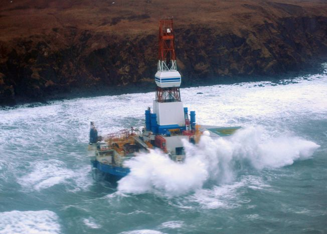 This image provided by the U.S. Coast Guard shows the Royal Dutch Shell drilling rig Kulluk aground off a small island near Kodiak Island on Jan. 1, 2013. A Coast Guard C-130 plane and a helicopter were used to fly over the grounded vessel. Severe weather did not permit putting the marine experts on board the drilling rig, which is near shore and being pounded by stormy seas. (Associated Press/U.S. Coast Guard)