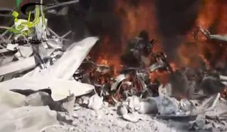 This citizen journalism image taken from video provided by Shaam News Network, which has been authenticated based on its contents and other AP reporting, shows a fire burning at the site of a Syrian government airstrike on a gas station in the eastern Damascus suburb of Mleiha, Syria, Wednesday, Jan. 2, 2013. Activists say dozens of people have been killed or wounded in an air raid on a gas station near the capital Damascus. (AP Photo/Shaam News Network via AP video)