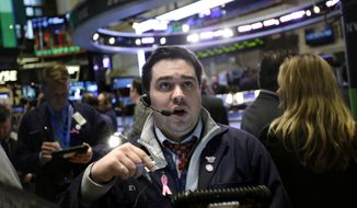 A trader works on the floor at the New York Stock Exchange in New York on Jan. 2, 2013. (Associated Press)