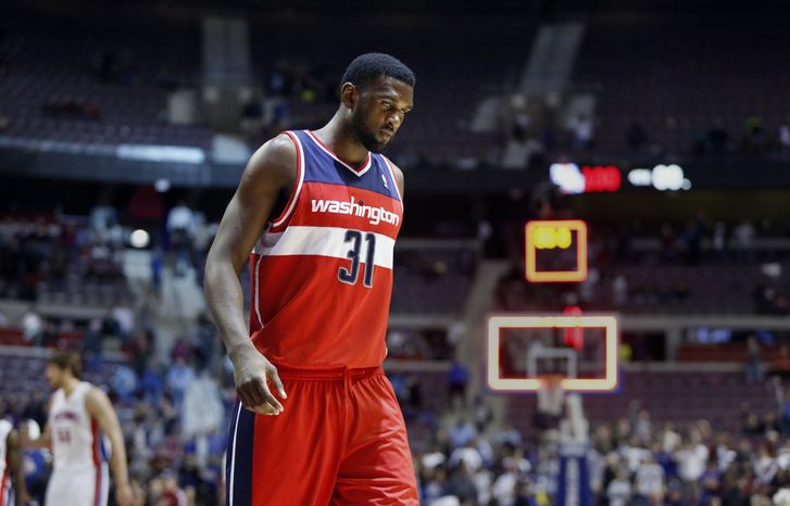 Washington Wizards forward Chris Singleton (31) walks off the court after a 100-68 loss to the Detroit Pistons in an NBA basketball game in Auburn Hills, Mich., Friday, Dec. 21, 2012. (AP Photo/Duane Burleson)