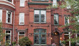 The home at 1708 P St. NW near Dupont Circle is on the market for $1,595,000. The circa-1900 Colonial-style brick row home has four finished levels with five bedrooms, three full baths and a powder room.