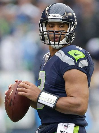Seattle Seahawks' Russell Wilson in action against the St. Louis Rams in the first half of an NFL football game, Sunday, Dec. 30, 2012, in Seattle. (AP Photo/Elaine Thompson)
