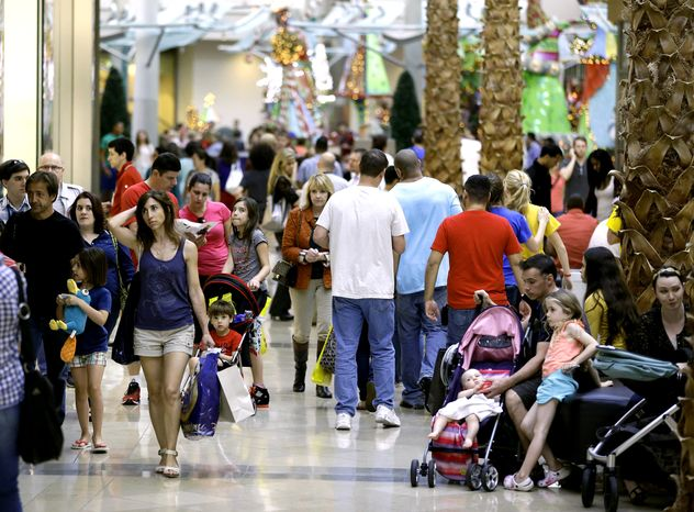 Holiday shoppers make their way through the Mall at Millenia in Orlando, Fla., on Thursday, Dec. 20, 2012. (AP Photo/John Raoux)