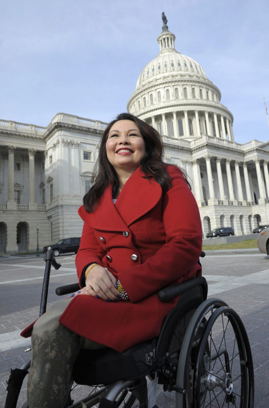 ** FILE ** Then Rep.-elect Tammy Duckworth, D-Ill. is seen on Capitol Hill in Washington, Thursday, Jan. 3, 2013, as she poses with other female House members prior to the official opening of the 113th Congress. (AP Photo/Cliff Owen)
