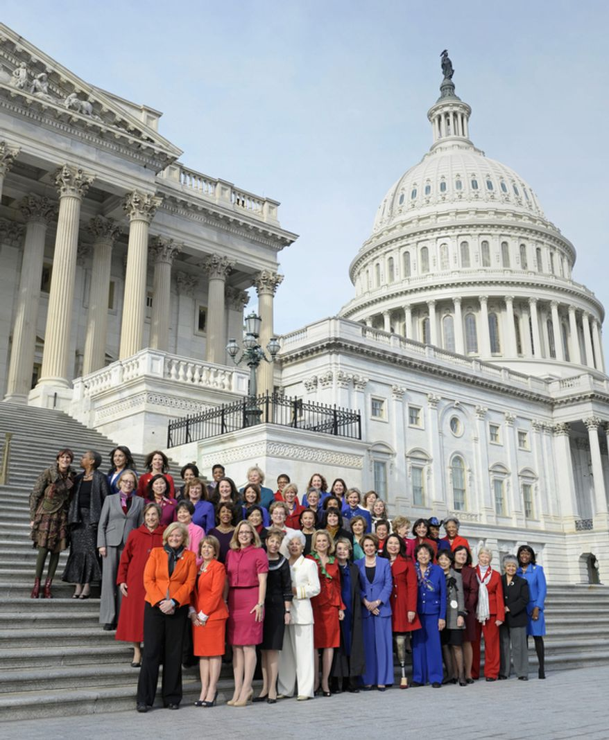 House Minority Leader Nancy Pelosi (front row), California Democrat, poses with other female House members on the steps of the U.S. House of Representatives on Capitol Hill in Washington on Thursday, Jan. 3, 2013, before the official opening of the 113th Congress. (AP Photo/Cliff Owen)