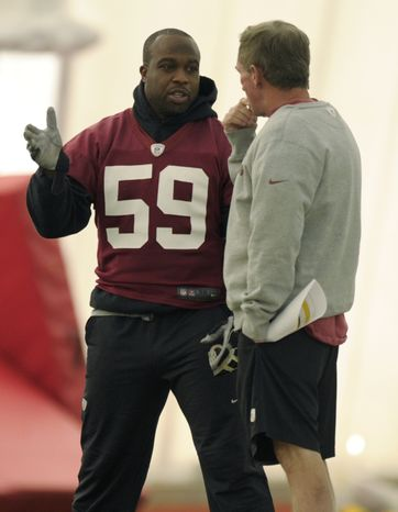Washington Redskins linebacker London Fletcher (59) talks with Redskins head coach Mike Shanahan, right, during a team workout at Redskins Park in Ashburn, Va., Wednesday, Jan. 2, 2013. The Redskins are working out before Sunday's wild card game against the Seattle Seahawks. (AP Photo/Susan Walsh)