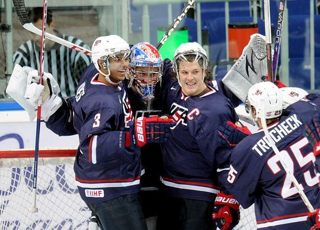 USA's team players celebrate during a semi-final match against Canada at  the World Junior Ice Hockey championship in Ufa, Russia, Thursday, Jan. 3, 2013. (AP Photo/Yuri Kuzmin, KHL)