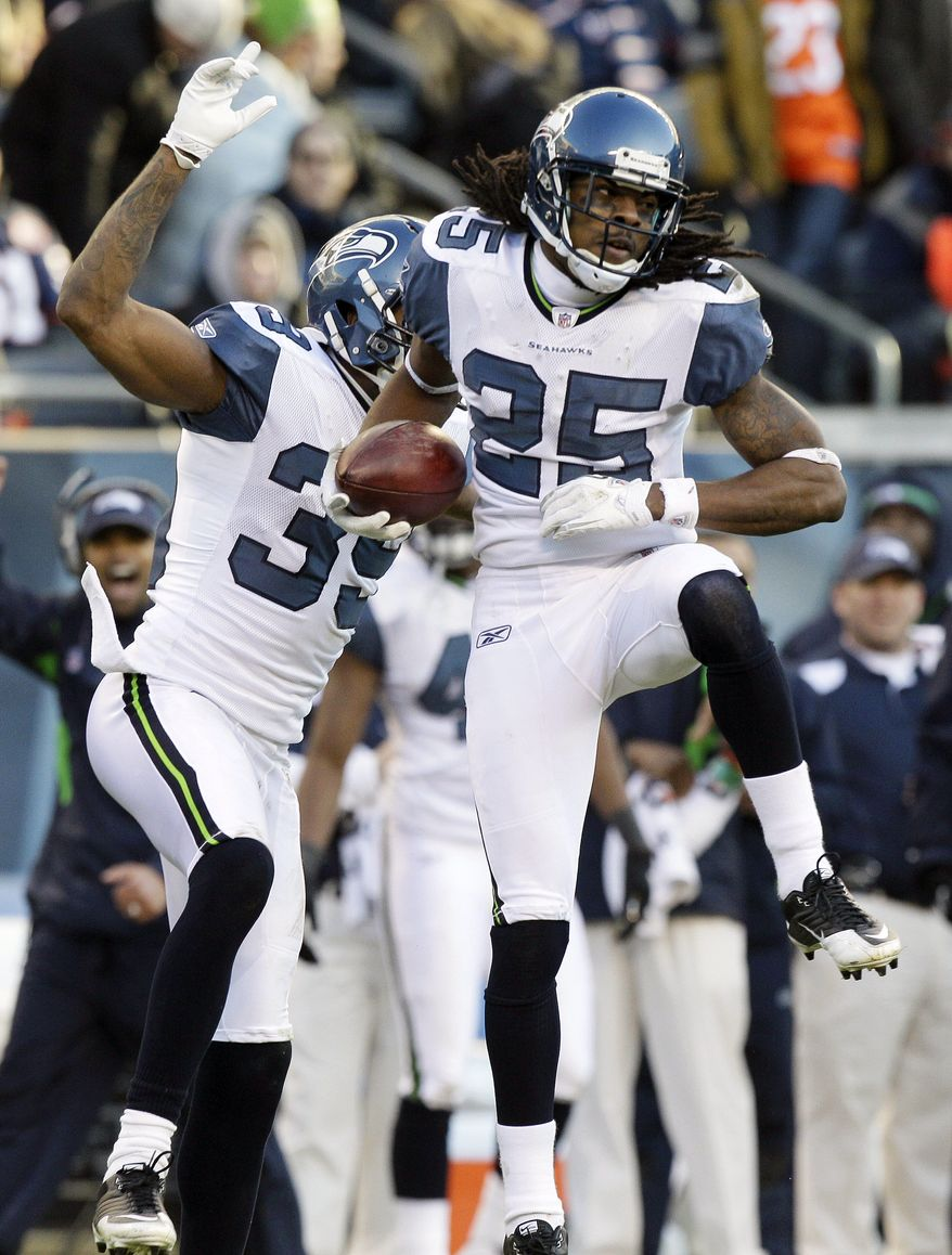 FILE - In this Dec. 18, 2011, file photo, Seattle Seahawks cornerback Richard Sherman (25) celebrates his interception against the Chicago Bears with teammate Brandon Browner (39) in the second half of an NFL football game in Chicago.  Browner is back from his four-game suspension for using a banned substance. Sherman won his appeal of a similar suspension. Instead of the Seahawks going into the playoff short-handed, they'll be nearly full strength. (AP Photo/Nam Y. Huh, File)