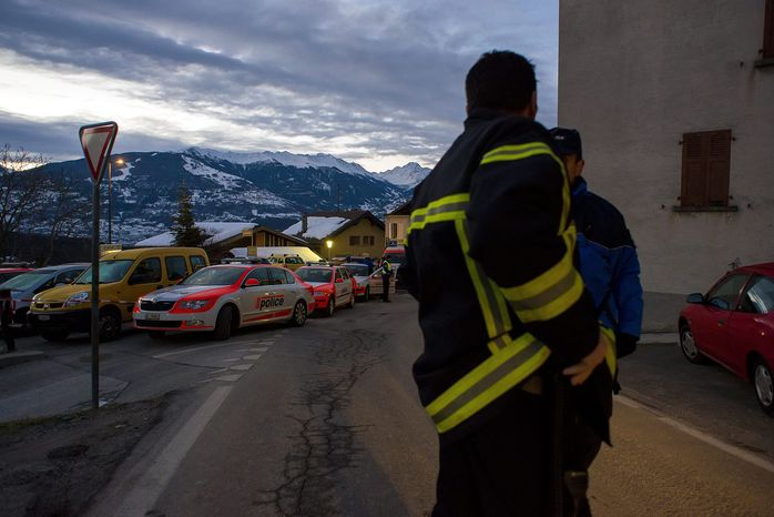 Police patrol in the village of Daillon, Switzerland, early on Thursday, Jan. 3, 2013, after a man shot and killed three people and wounded another two on Wednesday. (AP Photos/Keystone, Olivier Maire)