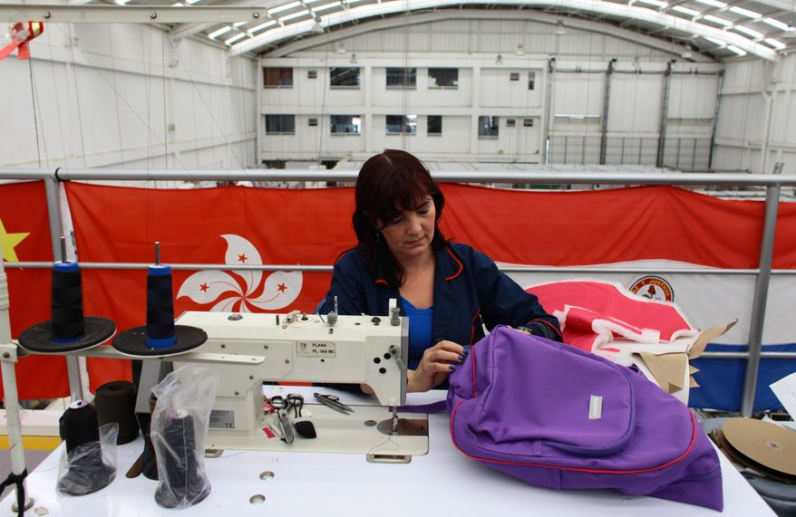 A seamstress works on an armored backpack designed for a child at the Miguel Caballero factory on the outskirts of Bogota, Colombia, on Jan. 3, 2013. Miguel Caballero who has made armored vests for adults for more than 20 years, said he had never thought about making bulletproof goods for children. (Associated Press)