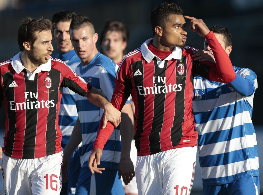 AC Milan Ghana midfielder Kevin-Prince Boateng (second from right) is flanked by his teammate Mathieu Flamini as he gestures towards the crowd in Busto Arsizio, near Milan on Jan. 3, 2013. A friendly match between AC Milan and lower division club Pro Patria was abandoned after racist chants directed at Milan's black players, the latest incident of racial abuse that continues to blight the sport. (Associated Press)
