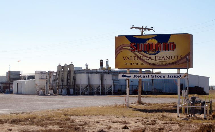**FILE** The Sunland Inc. peanut butter and nut processing plant in eastern New Mexico, near Portales, is seen here on Nov. 27, 2012. The plant has been shuttered since late September due to a salmonella outbreak that sickened dozens. (Associated Press)