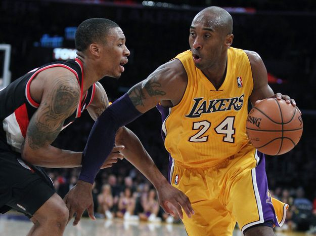 Los Angeles Lakers guard Kobe Bryant (24) drives against Portland Trail Blazers guard Damian Lillard, left, during the second quarter of an NBA basketball game, Friday, Dec. 28, 2012, in Los Angeles. (AP Photo/Alex Gallardo)